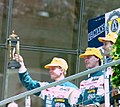 2nd placed Mauro Martini, Jeff Krosnoff & Eddie Irvine on the podium at the 1994 Le Mans (31933587856).jpg