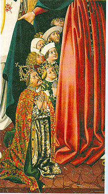 A crowned man with a moustache and blonde crowned lady on their knees, surrounded by other men and women on their knees