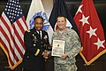 AMC commander presents award to Army Inspector General.jpg