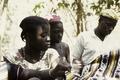 ASC Leiden - Coutinho Collection - E 12 - Shop in Sara, Guinea-Bissau - Woman touching the tissues - 1974.tif