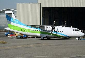 Marc Ravalomanana - Distribution airplane owned by Tiko