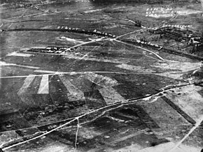 a black and white aerial photograph with markings showing key features