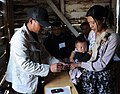 A Polling Officer administering the indelible ink to a female voter at a polling booth of Ukhrul district, during the Manipur Assembly Election on January 28, 2012.jpg