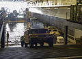 A U.S. Navy landing craft, air cushion unloads Marine Corps Humvee's and equipment assigned to the 26th Marine Expeditionary Unit in the well deck of the amphibious assault ship USS Kearsarge (LHD 3) in 130313-N-NK134-102.jpg