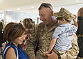A U.S. Sailor, center, with Explosive Ordnance Disposal Group 2 is greeted by his family upon returning to Norfolk, Va., June 1, 2013, after a 12-month deployment to Afghanistan in support of Combined Joint Task 130601-N-AP176-090.jpg
