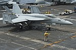A U.S. Sailor directs an F-A-18E Super Hornet aircraft assigned to Strike Fighter Squadron (VFA) 147 on the flight deck of the aircraft carrier USS Nimitz (CVN 68) in the Indian Ocean June 7, 2013 130607-N-LP801-006.jpg