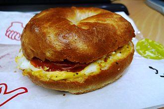 Abokado - Abokado toasted bagel with scrambled eggs and roasted tomato
