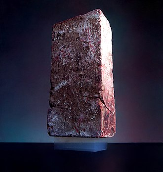 Aerogel - A 2.5 kg brick is supported by a piece of aerogel with a mass of 2 g.