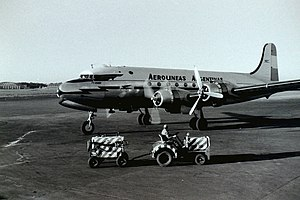 Douglas DC-4 - Aerolíneas Argentinas DC-4 starting engines at Buenos Aires international airport, ca. 1958.