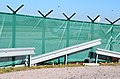 Airport Frankfurt - Fraport - Flughafen Frankfurt - fence with barbed wire and unfinished crash barrier - Zaun mit Stacheldraht und unfertiger Leitplanke.jpg