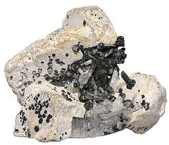 Alamosite - Transparent crystals of alamosite in the matrix of leadhillite and melanotekite