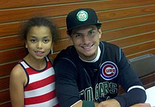 Albert Almora with a young fan 2013-08-20 00-58 (cropped).jpg
