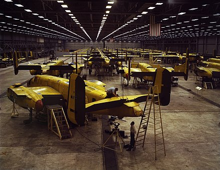 The common view among economic historians is that the Great Depression ended with the advent of World War II (assembling the North American B-25 Mitchell at Kansas City, 1942) Alfred T. Palmer - Assembling the North American B-25 Mitchell at Kansas City, Kansas (USA).jpg