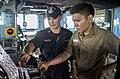 An ensign explains ship's steering aboard USS John S. McCain. (14768543752).jpg