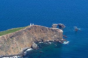 Anacapa Island - Anacapa's lighthouse is situated on the east end of the island. Sea arch (seen above) is at center right.