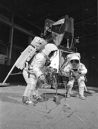 Moon landing conspiracy theories - Astronauts Buzz Aldrin and Neil Armstrong in NASA's training mockup of the Moon and lander module. Conspiracy theorists say that the films of the missions were made using sets similar to this training mockup.