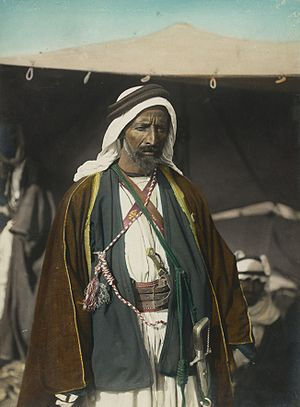 Auda Abu Tayi - Hand-colored photograph of Auda abu Tayi, probably taken by G. Eric Matson (1888-1977).Tabuk, Hejaz 1921
