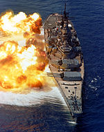 USS Iowa (BB-61) fires her 16-inch/50-caliber guns during a fire power demonstration sometime after her 1980s modernization.