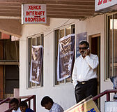 Bangalore sunglasses bindi guy on cellphone November 2011 -6-2.jpg