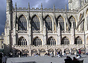 Flying buttresses at Bath Abbey, Bath, England. Of the six seen here the left hand five are supporting the nave, and the right hand one is suporting the transept. Notice their cast shadows on the windows