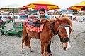 Beach boy and his horse.jpg