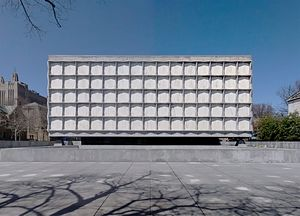 Beinecke Rare Book & Manuscript Library - On a bright day, the exterior enclosure of the Beinecke Library appears to float above its darkened entry level.