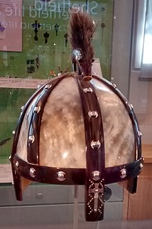 Colour photograph of the Benty Grange helmet replica on view at Weston Park Museum in Sheffield