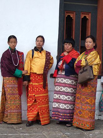 Costume - King of Bhutan in traditional dress and Bhutanese Women in traditional dress