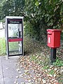 Bishopstone, postbox № SP5 316 and phone - geograph.org.uk - 1030434.jpg