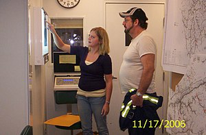 Patient education - A Radiographer explains an x-ray to a coal miner participating in screening. Patient education can include explaining the results of diagnostic tests.