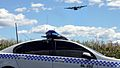 Blue Mountains 202 and RAAF Hercules on finals into Ricmond - Flickr - Highway Patrol Images.jpg