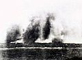 Bomb spray obscures the British cruiser HMS Exeter.jpg