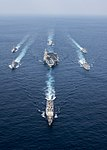 Bow view of Carl Vinson Carrier Strike Group photo exercise with Japan Maritime Self-Defense Force destroyers 170328-N-FC674-668.jpg