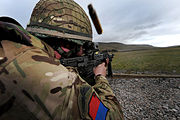 British Army Soldier Firing SA80 on a Practice Range MOD 45153627