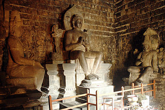 Mendut - The statue of Dhyani Buddha Vairocana, Avalokitesvara, and Vajrapani inside the Mendut temple