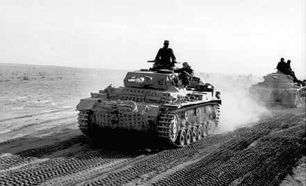 German Panzer III of the Afrika Korps advancing across the North African desert, 1941 Bundesarchiv Bild 101I-783-0109-11, Nordafrika, Panzer III in Fahrt.jpg