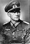 A black-and-white photograph of a military figure with a chest order in the shape of an Iron Cross.