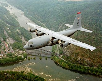 West Virginia Air National Guard - West Virginia ANG C-130H Hercules flying over Harpers Ferry, West Virginia, the junction of the Potomac and Shenandoah (left) rivers.