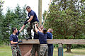 Cadets with the Junior Reserve Officers' Training Corps run through a confidence course.jpg