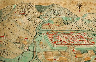 Celje - Celje, pictured in 1750. The Voglajna River can be seen on the left, flowing into the Savinja. The island district is called Otok (Slovene for 'island').