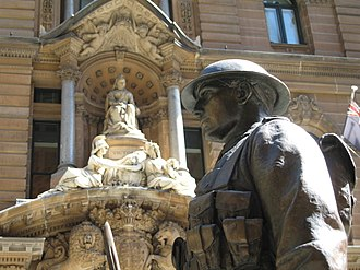 Sydney Cenotaph - Detail of the soldier statue, with the General Post Office in the background