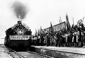 Chengdu–Chongqing Railway - A locomotive adorned with a portrait of Mao Zedong at the opening ceremony of the Chengdu-Chongqing Railway on July 1, 1952.