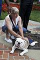 Cheryl Wankum, mother of honorary Marine Daran Wankum, not shown, pets the Marine Corps mascot, Sgt. Chesty XIII, at the Home of the Commandants at Marine Barracks Washington in Washington, D.C., June 13, 2013 130613-M-KS211-060.jpg