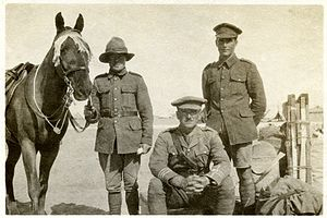 Claude Weston - Major Claude Weston (sitting) with his horse Billy in Egypt, in February or March 1916. The two other soldiers in the picture are Billy's groom and Weston's batman (servant).