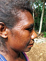 Close up image of a traditional Aorigi facial carving conducted at around age 12 on women and men. (10687087003).jpg
