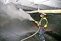 Coal miner spraying rock dust.jpg