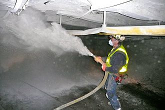 Miner - Image: Coal miner spraying rock dust