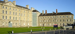 Facade of the former Collins Barracks with museum signage in the foreground.