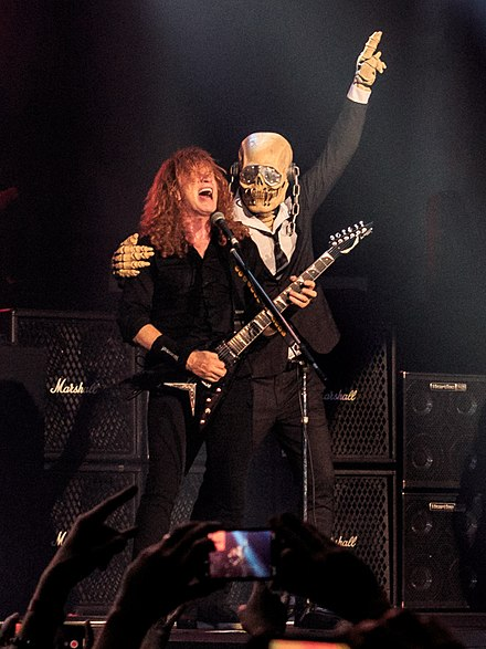 Vic Rattlehead next to Dave Mustaine on stage in 2018. Dave Mustaine and Vic Rattlehead.jpg