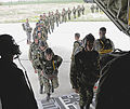Defense.gov News Photo 110429-F-BD819-507 - Members from the 435th Security Forces Squadron usher more than 50 Bulgarian air force paratroopers into a C-130J Super Hercules aircraft in.jpg